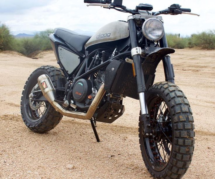 "On BikeBound.com:  The ""Duke Twins"" a pair of KTM 690 Duke scramblers by @droogmotoconcepts! How would you like to burn up the backroads on this wild and wolfish 73-hp #scrambler?"
