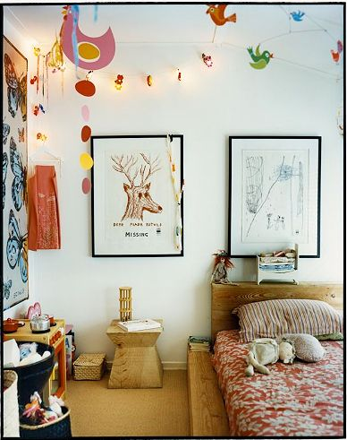 Organic boho child's room with natural wood furniture, living edge headboard.