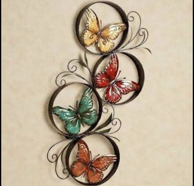 Wall piece from waste. Material used is used paper roll, plastic bottles for butterflies and quilling sheets