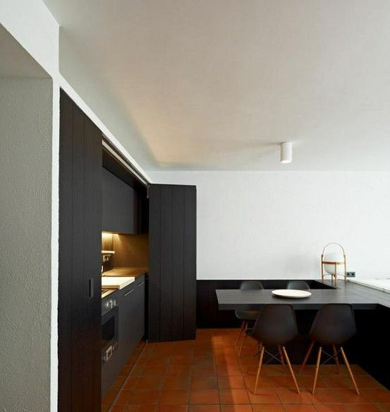 12 minimalist concealed kitchens for Matt black kitchen doors
