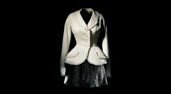 Christian Dior- CD's new look  was characterised by a small, cut in waist and a full skirt which would be down to the middle calf. The bust and waist were meant to be the focus