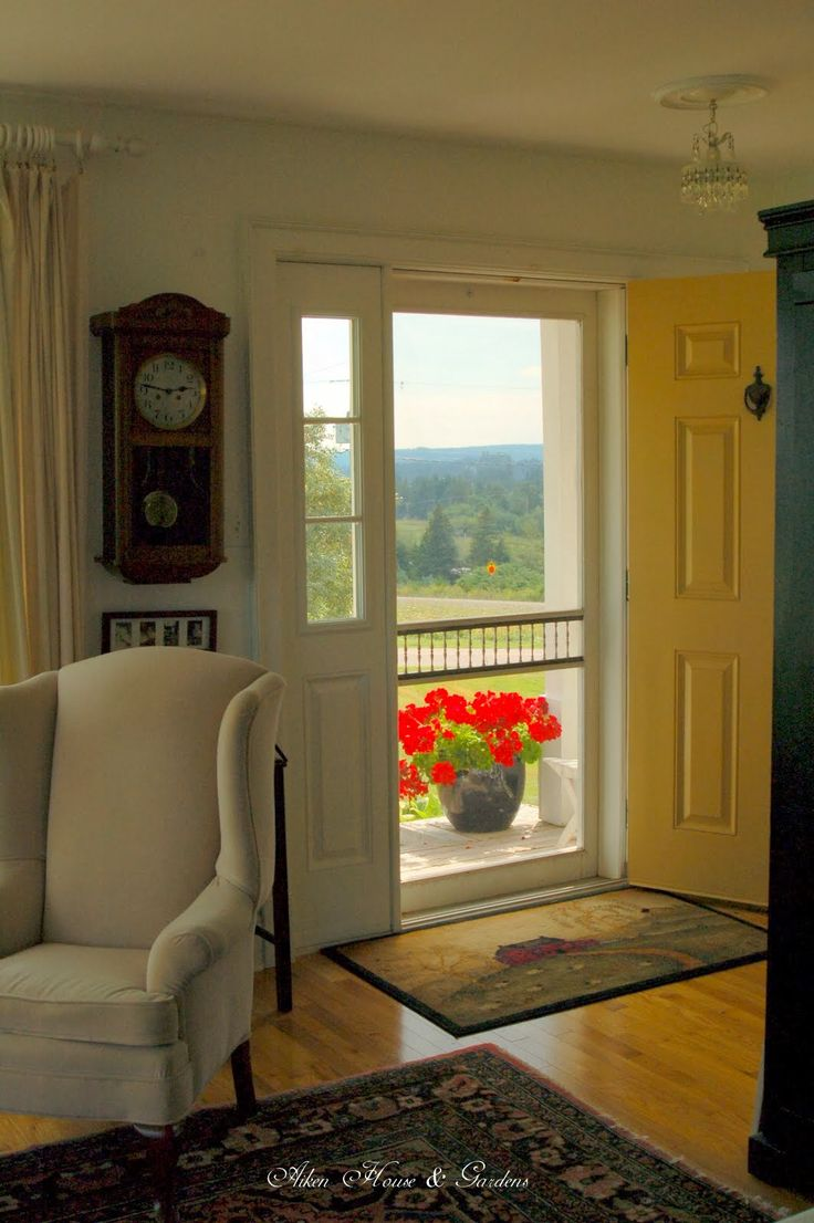 So lovely.  The entry, the view, the screened door, simple, clean, restful, gorgeous!