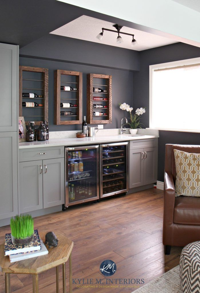 Sherwin Williams Cyberspace in home bar with reclaimed wood wine bottle display with beer fridge and Cambria Bianco Drift countertops. Kylie M INteriors E-design