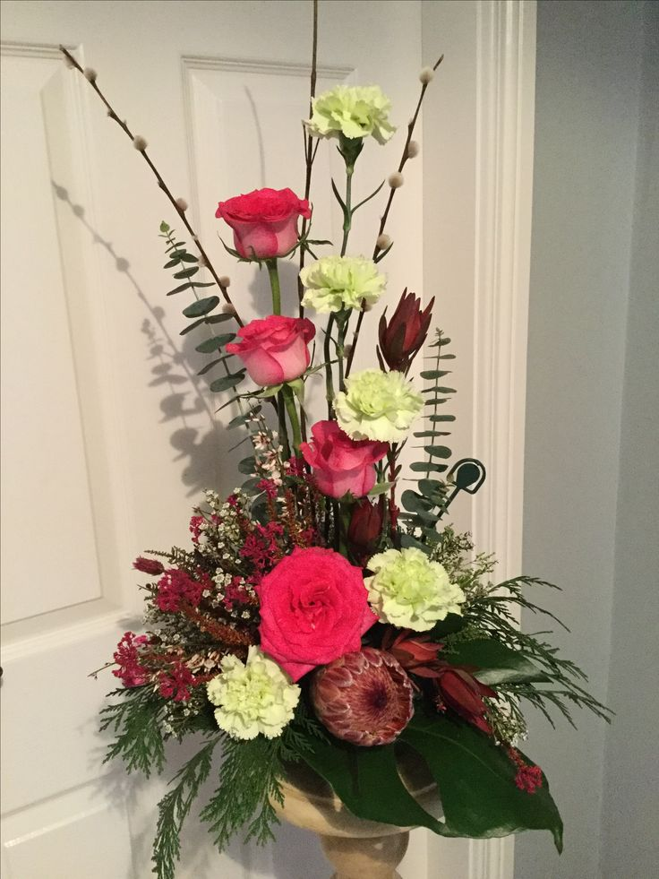 Protea, carnations and roses.