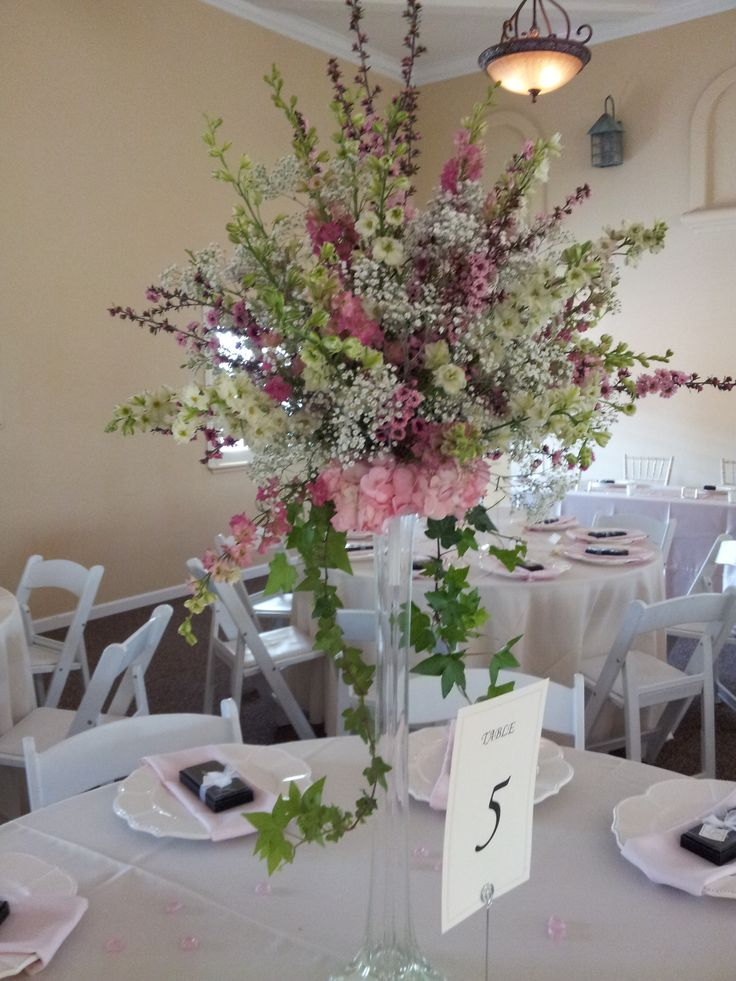 Eiffel tower vase with bouquets of whispy pink and white