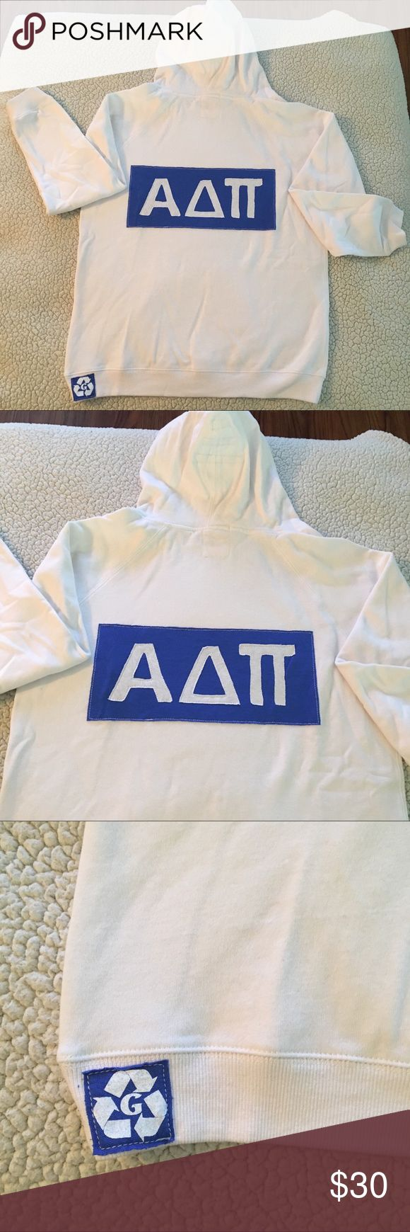 NWT Alpha Delta Pi white pull over sorority hoodie NWT Alpha Delta Pi white pull over hoodie w/ blue sorority lettering. Size AL. 50% poly 46% cotton 4% rayon.  V neck, draw string in hood, logo appliqué on back & solid front. Front kangaroo pockets. Made in USA. $62 retail. RARE and one of a kind. #greek #life #college #university #alpha #delta #pi #sorority #pledge #white #blue #big #little #sister #nwt #hoodie #vneck #fall #football #tailgate Never used. Smoke free home. Check closet for…