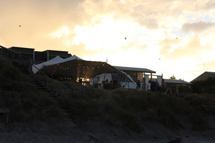 Beach wedding white stretch tents pukehina festoon lights