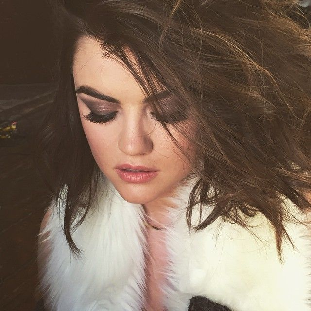 Gorgeous smokey eye and perfectly tousled hair on Lucy Hale | Pretty Little Liars Hair and Makeup