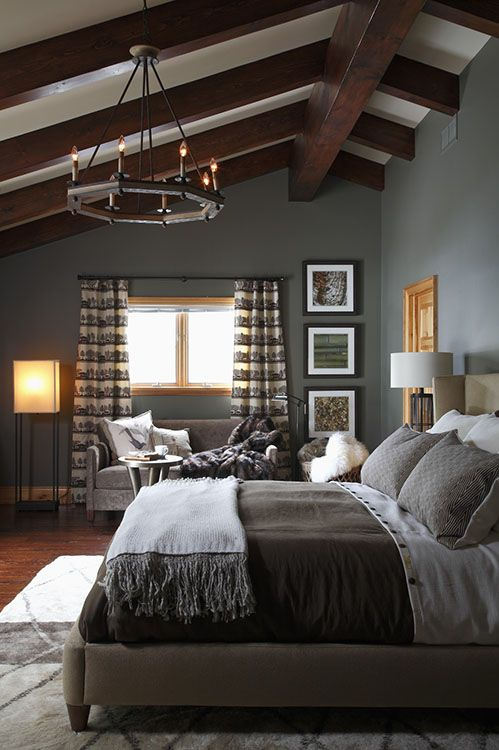 For bigger spaces with slanted roofs and ceiling double the normal height,. Beautifully styled grey bedroom looking elegantly
