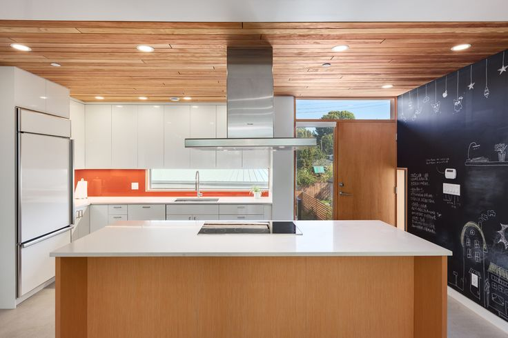 This passive/eco-home has a big and fun kitchen area which is great for families with kids. Parents can be in the kitchen cooking while watching the kids playing | Eco Home | West Coast Modern | Passive House | Photo taken by Two Column Marketing