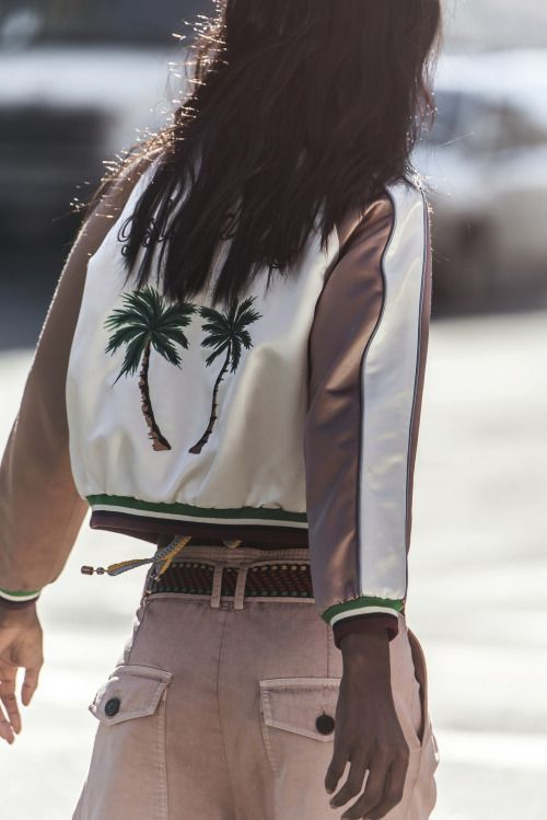 Tropical palm trees and an on-trend bomber jacket, what's not to love about that?