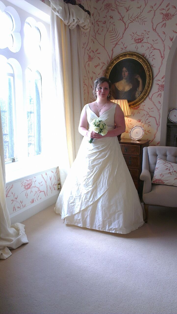 The blushing bride ready with her bouquet to walk down the aisle-Carlton Towers.