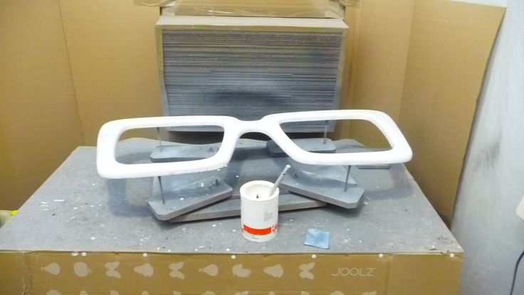 First real primer coat is applied to the unisex sun glasses...