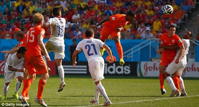 Head boy: Leroy Fer climbs to nod home and give Holland a 1-0 lead against Chile...