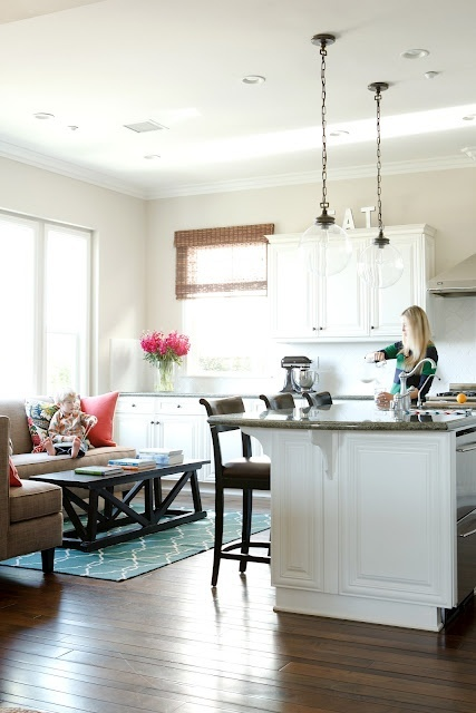 I love this idea of turning an eat-in-kitchen dining space into a sitting area.