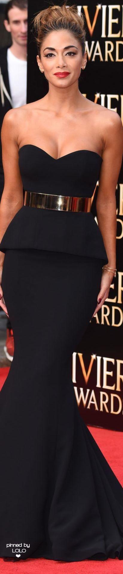 Nicole Scherzinger in a black strapless Galia Lahav gown with a gold metal belt.