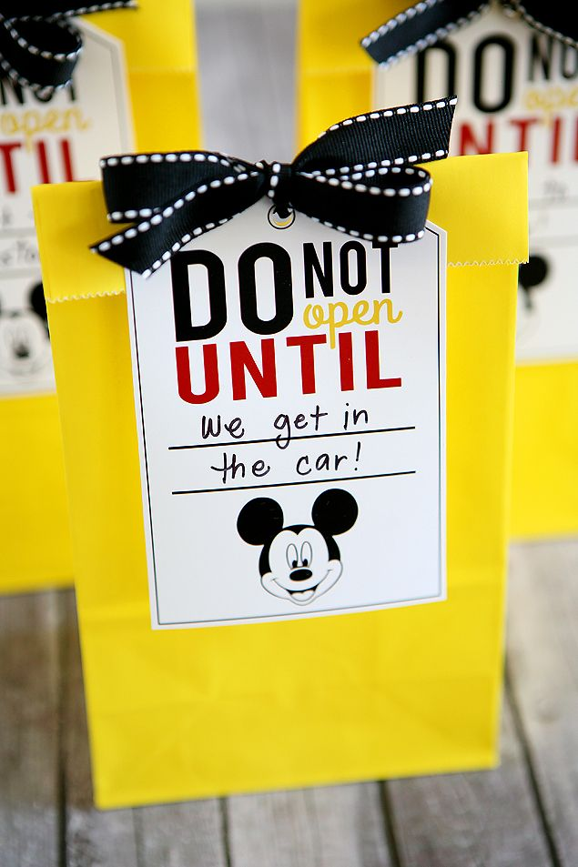 "Disney Trip Fun Bags - could be fun if they were plain and we asked them to open it up with a ""guess what.... WE'RE GOING TO DISNEYLAND PARIS AGAIN!!"""