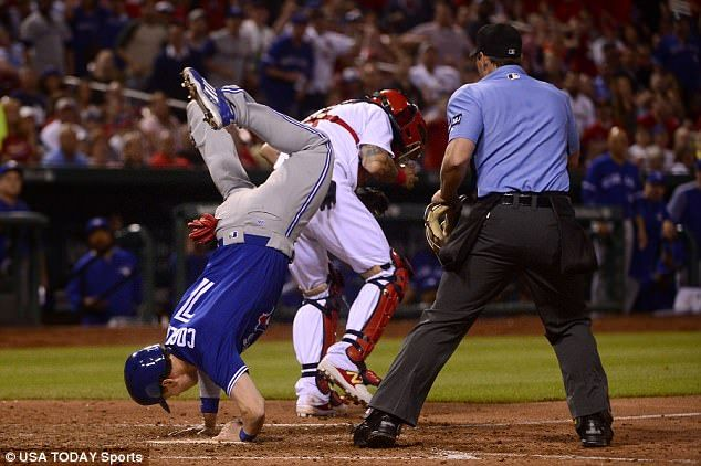 He and the ball arrived at just the same time at the home plate. Cardinals catcher Yadier Molina caught the ball and looked to tag Coghlan, but it was too late