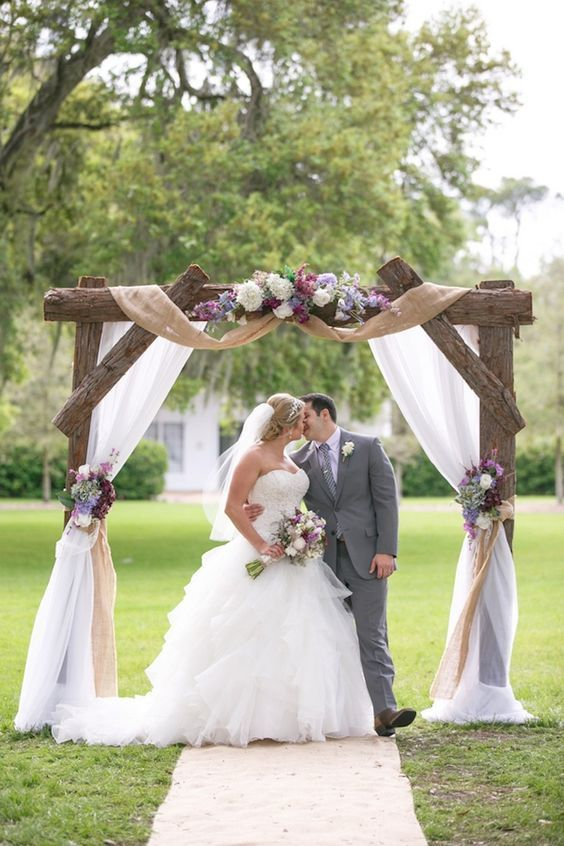 rustic burlap and wooden wedding arch / http://www.deerpearlflowers.com/wedding-ceremony-arches-and-altars/
