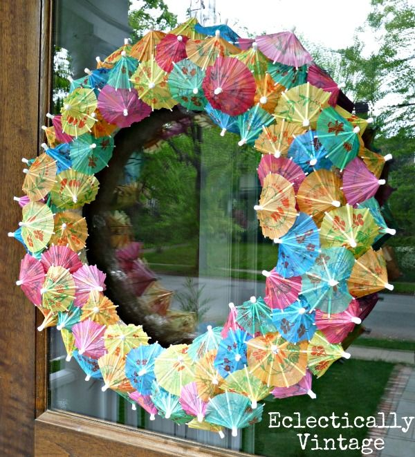 Cocktail Umbrella Wreath. Wouldn't this be sweet for April (April Showers bring May Flowers)?  It only costs a dollar or two to make, and is so striking.