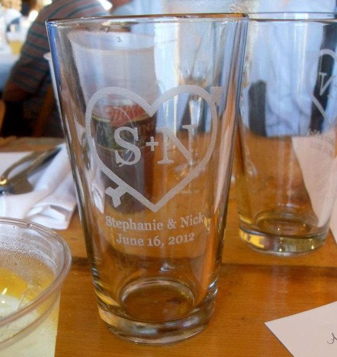 24 Custom Engraved Pint Glasses: Wedding Favors. $96.00, via Etsy.