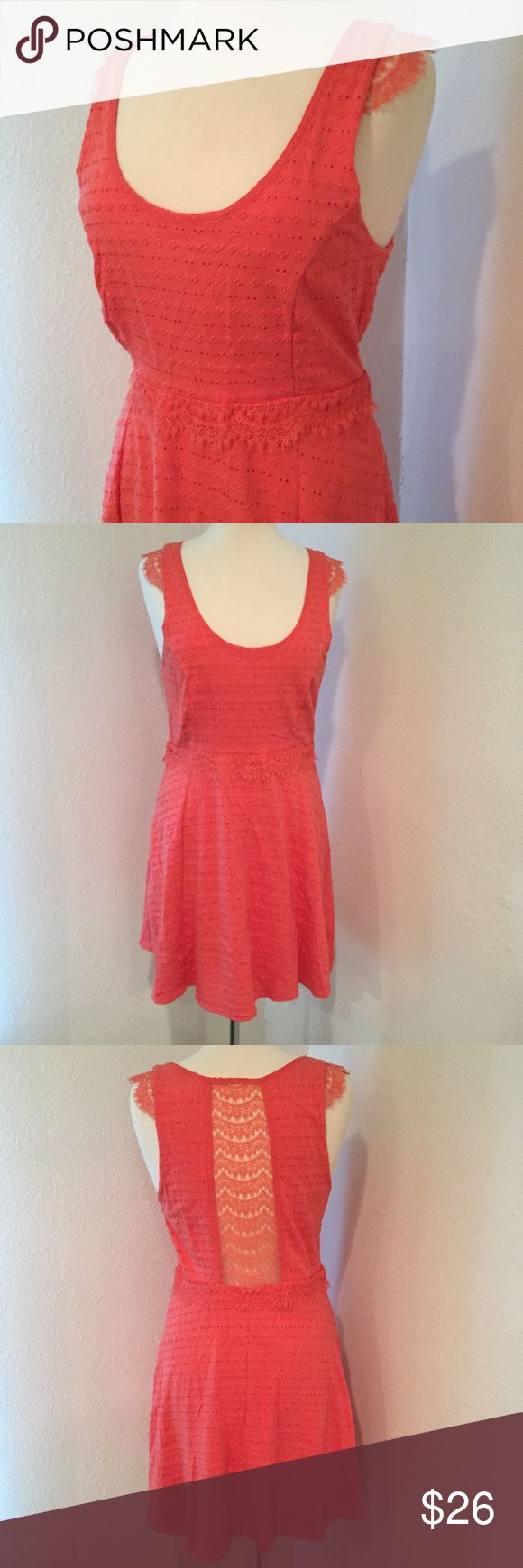 Free People Coral Eyelet & Lace Dress Bright and beautiful dress is accented with lace inset at back and lace cap sleeves. In very good condition. Free People Dresses