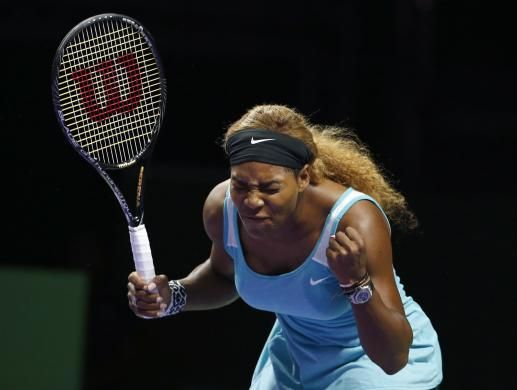 Serena Williams reacts as she plays against Simona Halep of Romania during their WTA Finals singles tennis match at the Singapore Indoor Stadium October 22, 2014.  REUTERS/Edgar Su