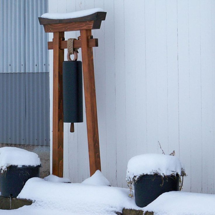 "In case you were wonder, yes the ""Torii with Bell"" does look good in the snow! And for inquiring minds, the bell emits a peaceful sound soothing to the ear. It can be used to announce one's presence or just for fun. #outdoorspace #westernredcedar #pacificpergola #architecturallandscape #gardengate #entrygate #landscapedesign #gardengong #gong #gardenbell #custommade http://etsy.me/2kJMvEz"