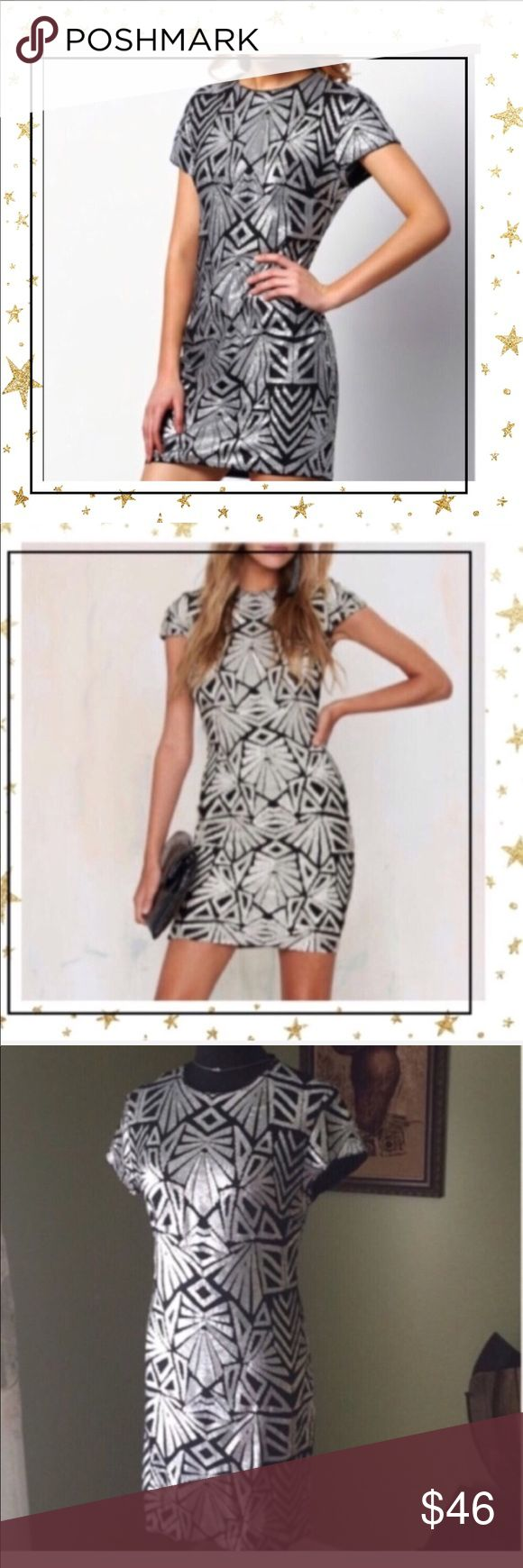 Silver Night Out Mini Dress (G7NC20Z) New, never worn. Cup sleeve. Size runs smaller. Bust 97sm, length 84 sm. Dresses Mini