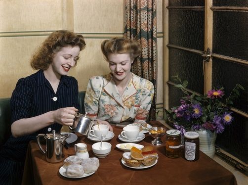 Off-duty waitresses sit down to drink tea and eat pastries - Dundee, Tayside, Scotland, Great Britain.