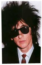 "JOHN COOPER CLARKE -  is an English performance poet who first became famous during the punk rock era of the late 1970s when he became known as a ""punk poet"". 'Health Fanatic (live)' video: http://youtu.be/dmAuSuV4IP0"