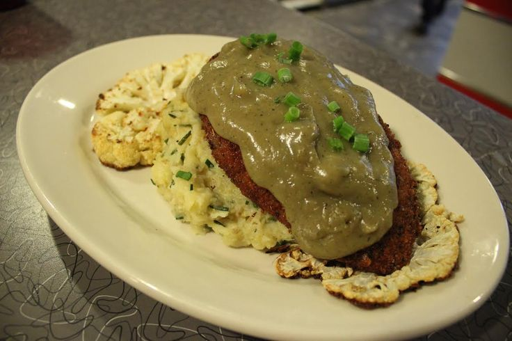 Week of Nov. 26, 2014: Our house-made Seitan Cutlet is served with a Parsnip Potato puree w/Chives, Roasted Cauliflower Steaks, SUNCHOKE GRAVY and Cranberry Chutney. #vegan www.veggiegalaxy.com