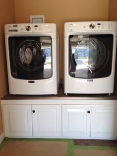 "Front load washer and dryer sitting on a 24"" tall pedestal"