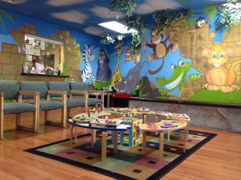 Fun waiting room at Kids Dental Care Center for Advanced Pediatric Dentistry. Call for an appointment today or to schedule a free puppet show for your child care facility!