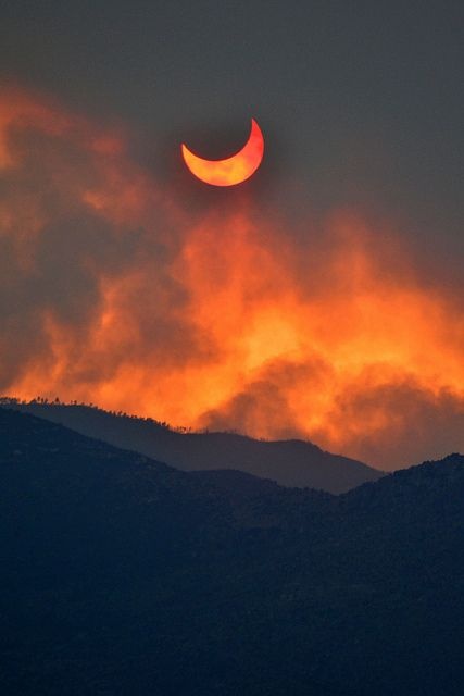 Eclipse, seen through the smoke of the wildfires near Sunset Point, just north of Phoenix, Arizona.