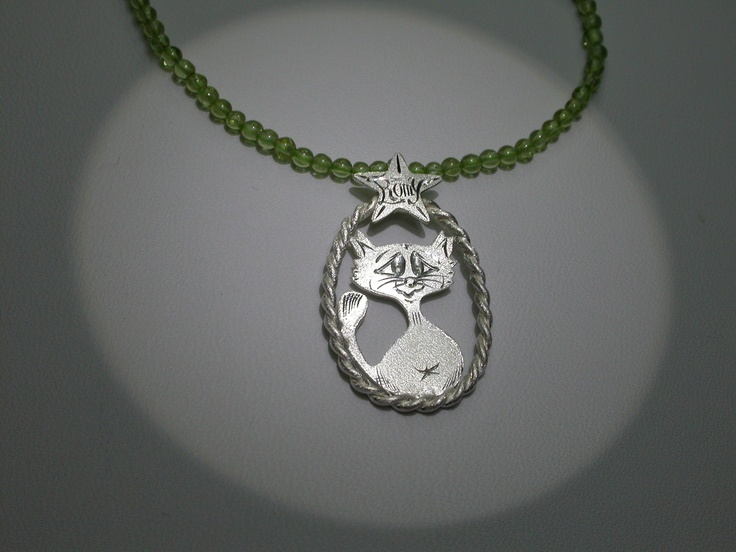 A little girl lost her favorite pet a few days before her Holy Communion ... Maybe so Romy could still be present?  Silver necklace with engravings and peridot beads.  Inemoni