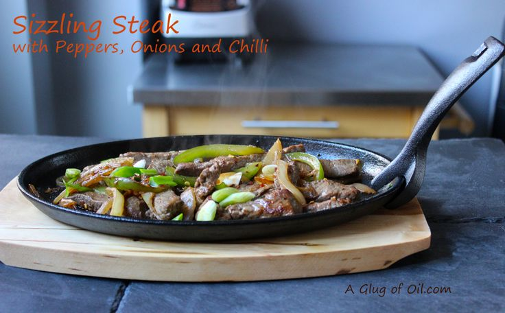 A Glug of Oil: Sizzling Steak with Peppers Onions and Chilli
