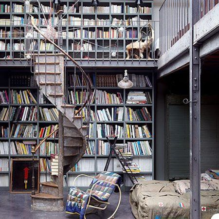 A double level home library in a loft in Paris, France. [via]: Bookshelves,  Bookstal, Spirals Stairs, Dream Libraries, Homes Libraries,  Bookstore, Dream Job, Spirals Staircase, House