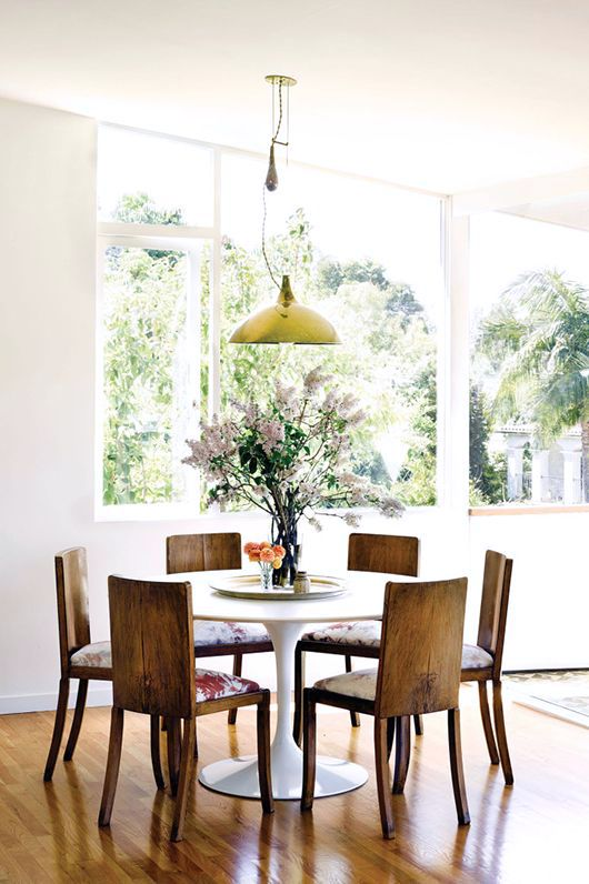 We Love This Pairing Of Solid Wood Dining Chairs Free Of Ornamentation With  A Sleek Tulip Table. A Painterly Fabric On The Chairs Softens The  Combination, ...