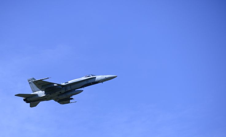 Tail Number (756): A CF-18 Hornet fighter jet does a familiarization flight of the region in Câmpia Turzii, Romania during NATO reassurance measures on May 13, 2014.   Photo by MCpl Patrick Blanchard, Canadian Forces Combat Camera (IS2014-3023-09)