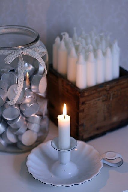 I like the idea of having the supply of extra candles handy and displayed in an old wood box.