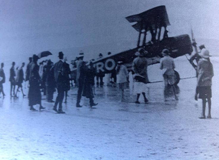 tiger moth lands on main beach Byron Bay 1920's