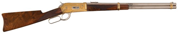 Winchester Model 1886 rifle    Manufactured by Winchester Repeating Arms Co c.1898 and fancied up by factory master engraver John Ulrich - serial number 114694.  .45-90 Winchester Center Fire nine-round tubular magazine, lever action manual repeater, engraved and gold/nickel plated.