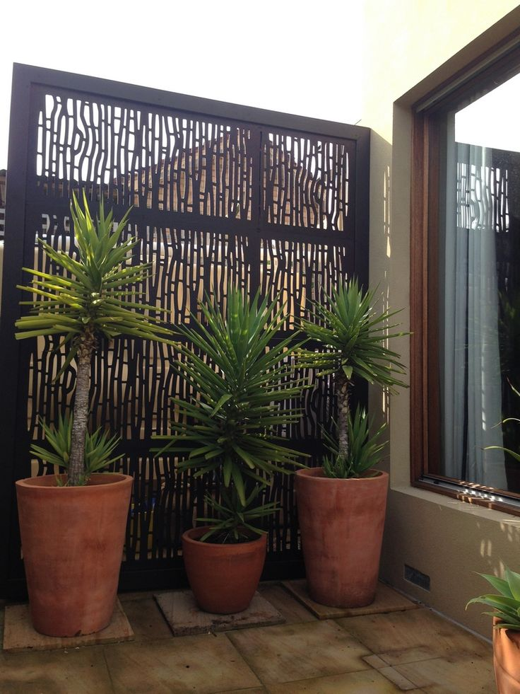 Photo sent by one of our customers - Bungalow design screens used to hide a water tank.