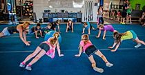 This simple activity is based on the classic game of hot potato and works well as a warm-up for young athletes. All you need is a bit of floor space and an exercise ball to create a fun game of hot potato for your CrossFit Kids. Simply circle the troops, get them into a plank position and have them bat a ball around the circle. The last one to touch it before the music stops does a few reps of another movement, and then the game starts again.