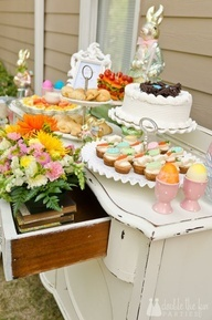 desserts and different heights: brownies on tray, cookies on 3 tier stand, fruit bowl