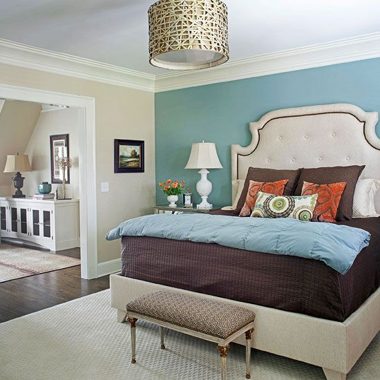 Master Suite. Raising, then extending, the roof in the attic accommodates an amply proportioned master suite, complete with a spacious bedroom, seating area, and bathroom. The addition nearly doubles the home's size, providing plenty of space for the couple's budding family. Love all the textures and color choices.