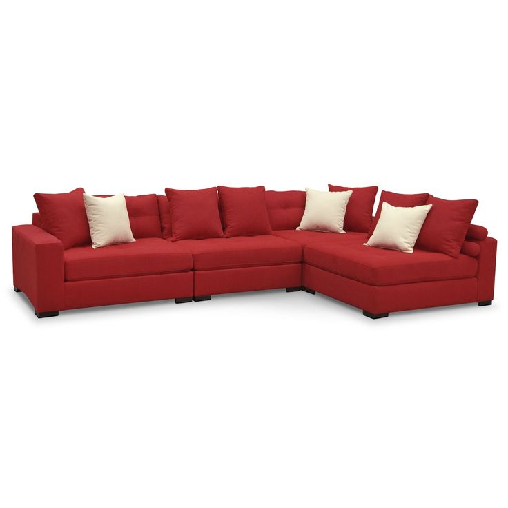 Handcrafted Design. Built for durability and versatility, the Venti Red four-piece sectional by Kroehler™ is an oversized sectional that will round out your living room with looks and longevity. It's upholstered, tailored, and handcrafted by skilled craftsmen and is swathed in warm, vibrant cloth that feels luxurious against your skin. Extra details include tufting along all the attached seat and back cushions, each section comes with two back pillows and the wood block legs are almost in...