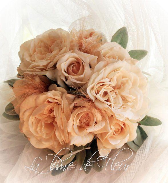 Jane W's Bridal bouquet  Cream David Austin Sophia roses, cream Columbian roses, lambs ear foliage and tufts of rare Egret feathers.