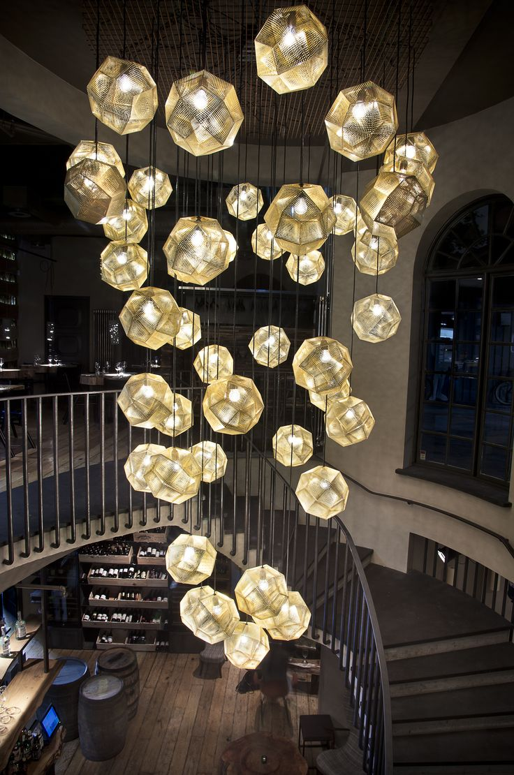 A cascade of Tom Dixon Etch Pendant Lights comprise a dazzling display in Iceland's Grill Market restaurant.